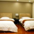 Jiuduhui Apartment Hotel
