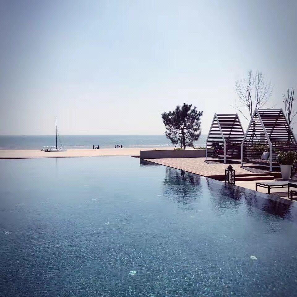 秦皇岛阿那亚黄金海岸社区听海原意别墅是什么别墅图片