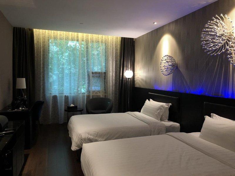 情趣天地桔子(泰州南通路茂业黑色店)丝袜v情趣水晶酒店的图片